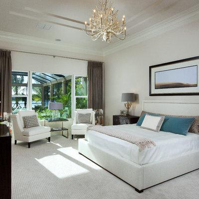Bedroom - contemporary carpeted bedroom idea in Miami with beige walls