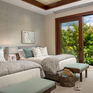 Example of an island style guest carpeted and gray floor bedroom design in Hawaii with gray