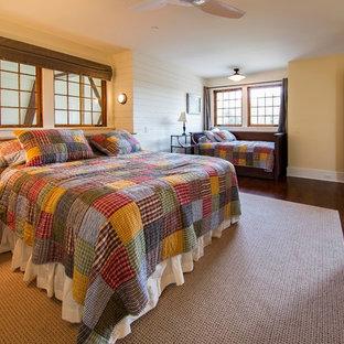 Bedroom - farmhouse dark wood floor and brown floor bedroom idea in Baltimore with yellow walls