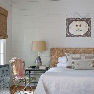 Bedroom - coastal medium tone wood floor bedroom idea in Atlanta with white walls