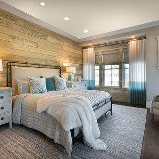 Design ideas for a beach style bedroom in Charleston with brown walls, dark hardwood floors and brown floor.