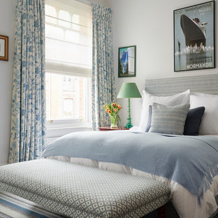 Design ideas for a large bohemian master bedroom in London with white walls and carpet.