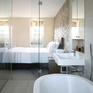Example of a trendy master bedroom design in London with beige walls