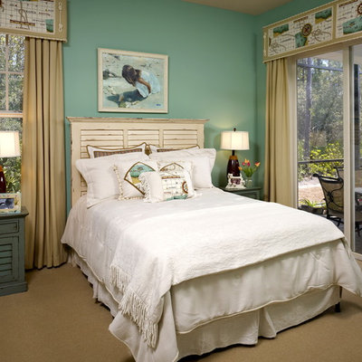 Bedroom - mid-sized tropical guest carpeted and beige floor bedroom idea in Jacksonville with green walls and no fireplace