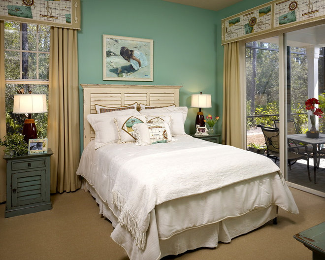 Tropical Bedroom by Lendry Homes