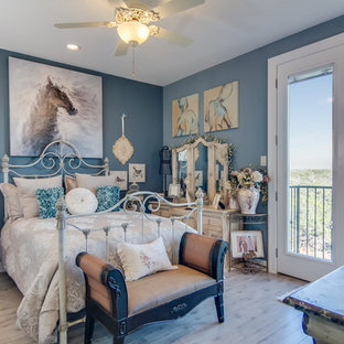 Inspiration for a mid-sized shabby-chic style guest light wood floor bedroom remodel in Austin with blue walls and no fireplace