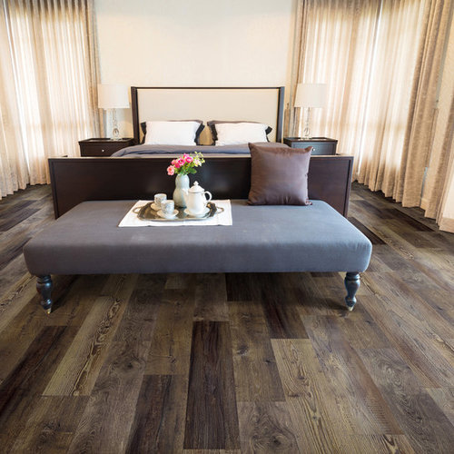 Inspiration For A Contemporary Bedroom Remodel In Other With Dark Hardwood Floors