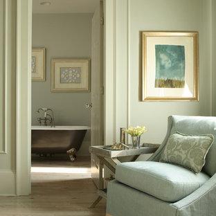 Inspiration for a timeless light wood floor and beige floor bedroom remodel in Atlanta with beige walls
