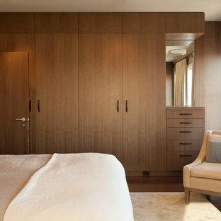 Contemporary bedroom in San Francisco with dark hardwood flooring.