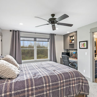 Example of a cottage guest carpeted and beige floor bedroom design in Grand Rapids with gray walls