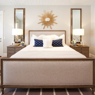 Transitional medium tone wood floor bedroom photo in Phoenix with beige walls