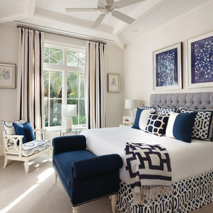 Inspiration for a transitional master carpeted bedroom remodel in Miami with beige walls