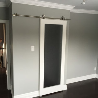 Inspiration for a mid-sized contemporary master bedroom in Toronto with grey walls, dark hardwood floors and brown floor.