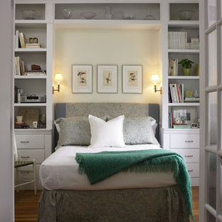 elegant bedroom photo in boston - Bookshelves Around Bed