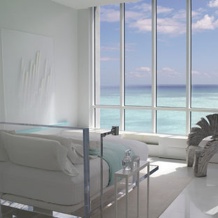 Bedroom - tropical bedroom idea in Miami with white walls