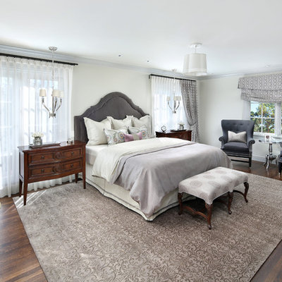 Bedroom - large traditional guest dark wood floor bedroom idea in San Francisco with white walls