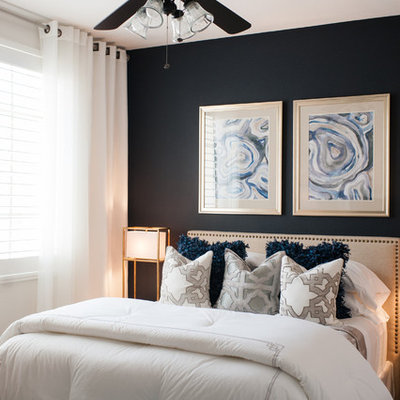 Small transitional guest carpeted bedroom photo in Las Vegas with blue walls
