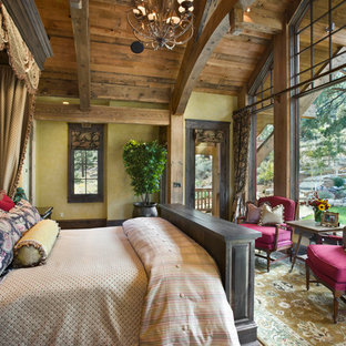 Inspiration for a rustic bedroom remodel in Other with beige walls
