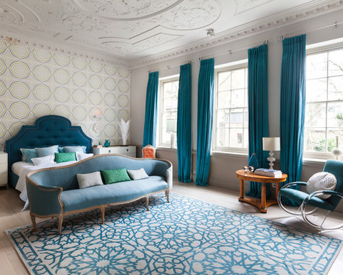Large Trendy Master Bedroom Photo In London With Multicolored Walls And Light Wood Floors