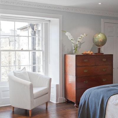 Bedroom - eclectic dark wood floor bedroom idea in Other with gray walls