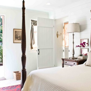 Example of a small cottage chic bedroom design in Charleston with white walls