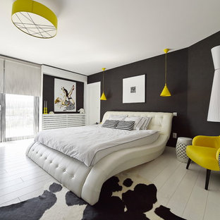This is an example of a small contemporary master bedroom in Other with black walls, laminate floors and white floors.