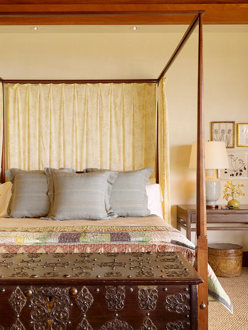 Island style carpeted bedroom photo in Hawaii with beige walls & Full Tester Canopy Bed | Houzz
