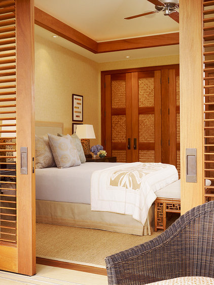 Tropical Bedroom by GM Construction, Inc.