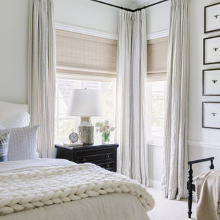 Inspiration for a timeless carpeted, beige floor and wainscoting bedroom remodel in Kansas City with white walls