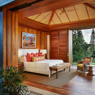 Inspiration for a tropical master medium tone wood floor bedroom remodel in Hawaii with no fireplace