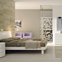 Karisma Contemporary Platform Bed Made In Italy - A mixture of traditional blend of furniture, the Karisma Made in Italy bedroom set is another Drop collection that features arched outlines and bomb-shaped surfaces. The complete bedroom set is in white ash wood but what is interesting are the wooden handles of both the dresser and the two nightstands. All are accessible in various wood finishes. Customized per your requirements are the case goods to ach. Delivery of this modern and luxurious bed set is 8 12 weeks.