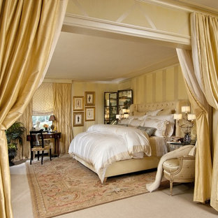 Inspiration for a mid-sized timeless master carpeted and beige floor bedroom remodel in New York with beige walls