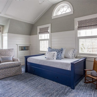 Inspiration for a mid-sized transitional loft-style bedroom in Boston with grey walls, medium hardwood floors, no fireplace and blue floor.