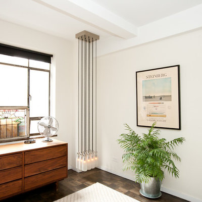 Example of an eclectic bedroom design in New York with white walls