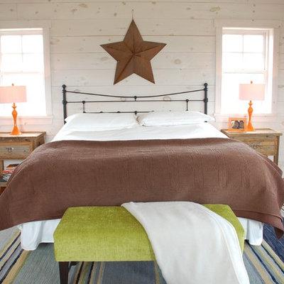 Bedroom - eclectic medium tone wood floor bedroom idea in Toronto with white walls
