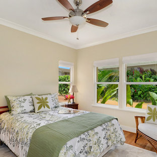 Bedroom - mid-sized tropical guest medium tone wood floor and brown floor bedroom idea in Hawaii with beige walls and no fireplace