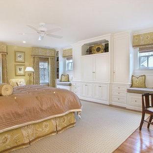 Bedroom - traditional medium tone wood floor bedroom idea in Newark with beige walls