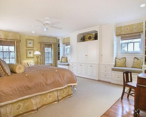 Traditional Medium Tone Wood Floor Bedroom Idea In Newark With Beige Walls