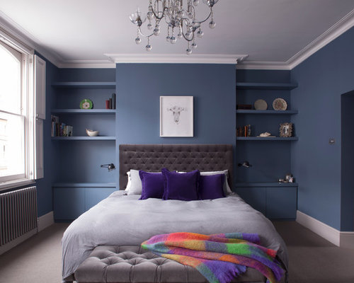 trendy bedroom photo in london with blue walls carpet and gray floors - Bedroom Walls Color