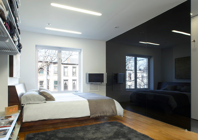 Modern Bedroom by SLADE ARCHITECTURE