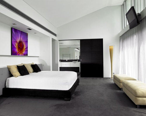 this is an example of a contemporary bedroom in brisbane with white walls and carpet - Bedroom Carpet Ideas