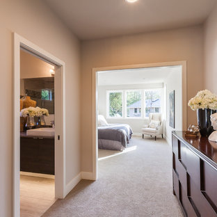 Inspiration for a mid-sized modern master carpeted bedroom remodel in Seattle with beige walls
