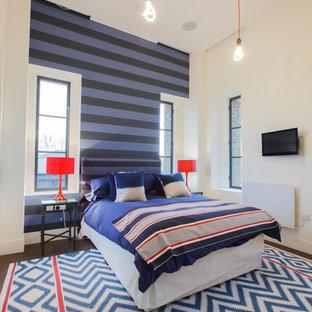 Bedroom - contemporary bedroom idea in London with multicolored walls