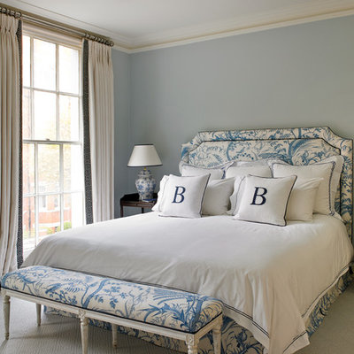 Inspiration for a timeless carpeted bedroom remodel in London with blue walls