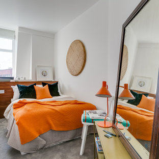 Inspiration for a small contemporary bedroom in London with white walls, carpet and grey floors.