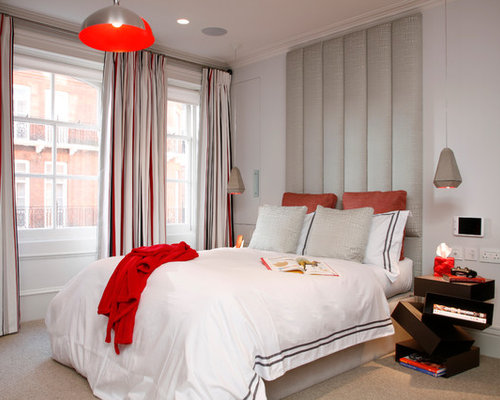 Example Of A Mid Sized Trendy Carpeted Bedroom Design In London With White  Walls