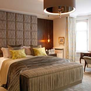 Inspiration for a contemporary carpeted bedroom remodel in London with beige walls