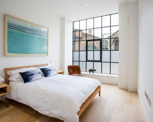 Design Ideas For An Urban Bedroom In London With White Walls And Light  Hardwood Flooring.