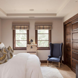 Mid-sized elegant guest limestone floor and beige floor bedroom photo in San Francisco with beige walls and no fireplace