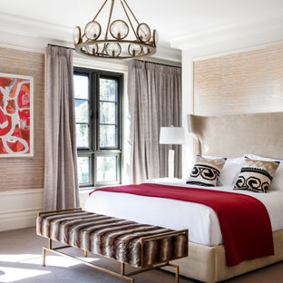 Transitional bedroom in Melbourne with beige walls, carpet, grey floor, panelled walls and wallpaper.